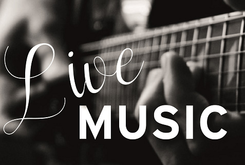 Live Music text over a man playing guitar
