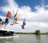 Children jumping off boat.